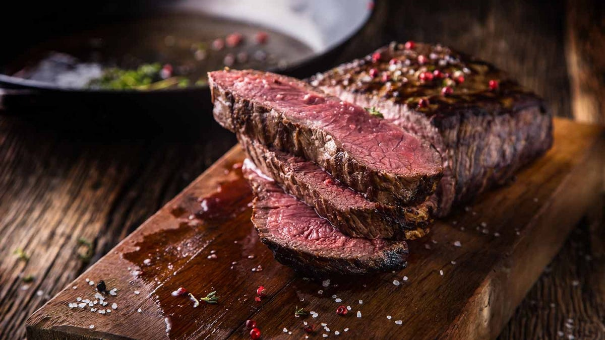 a beautifully seared steak cut to reveal a tender middle