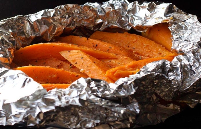 A foil packet with sweet potato wedges