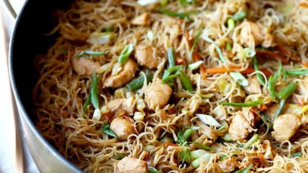 pan of rice noodles, chicken, and vegetables