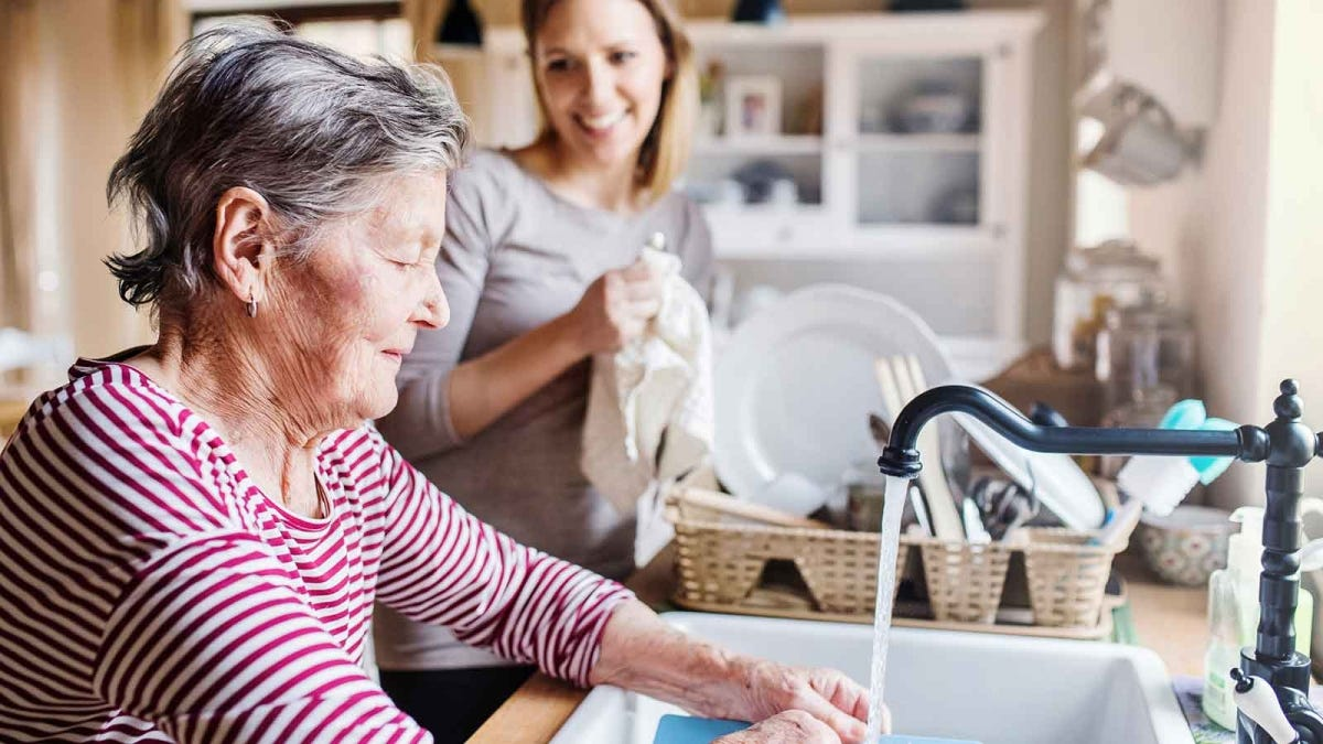 an adult woman and her mother working together to prepare for Thanksgiving