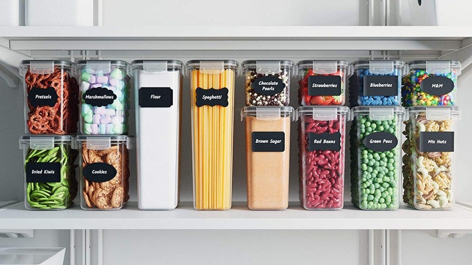 A pantry shelf stacked with Chef's Path brand of food containers.
