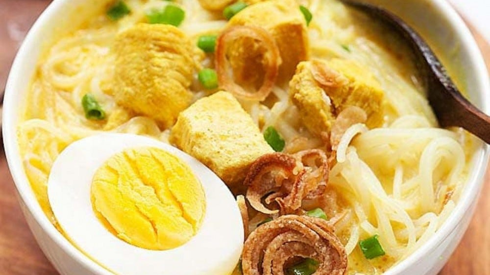 bowl of chicken soup with hard boiled egg