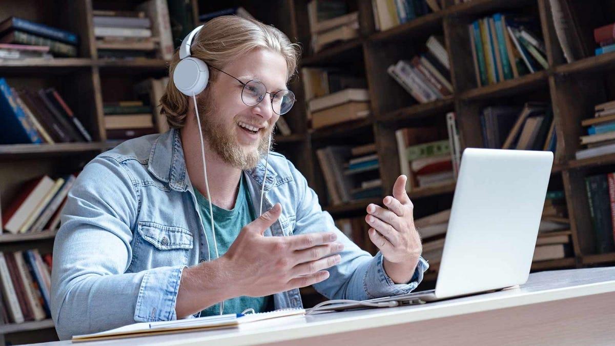 Man teaching classes online using his laptop.