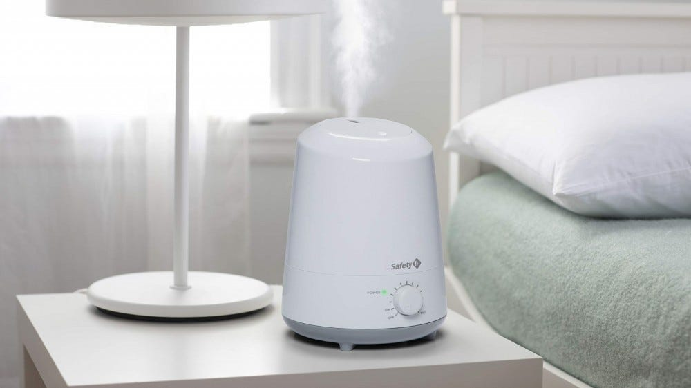 The Safety 1st Humidifier on a bedside table.