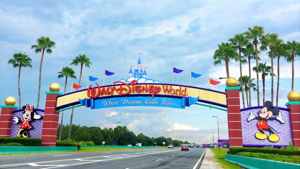 "The ""Where Dreams Come True"" sign at the entrance of Walt Disney World in Florida."