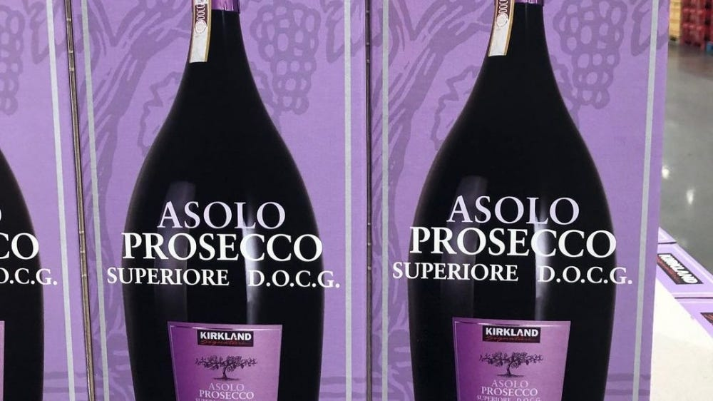 Boxes of three liter sizes of prosecco sit lined up in a costco.