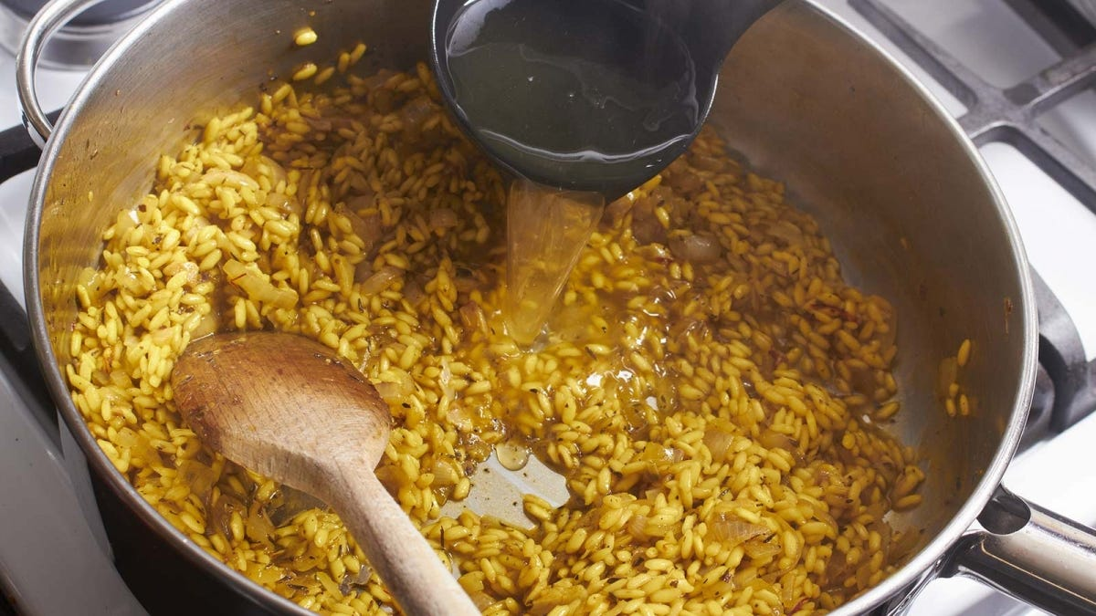 A pot of risotto cooking on the stove.