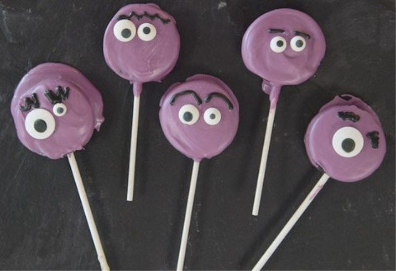 Chocolate dipped Oreo lollipops, with little monster faces.