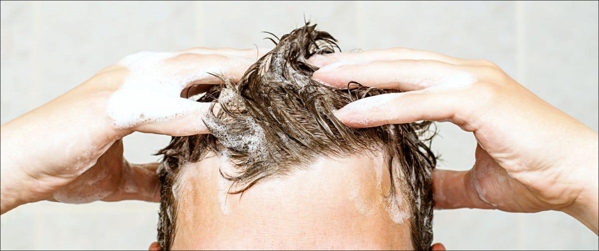 young man washing his hair