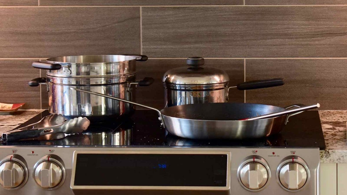 Various pans on a stainless steel stove.