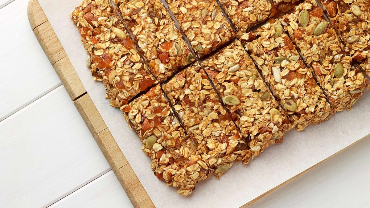 Homemade granola bars on a cutting board.