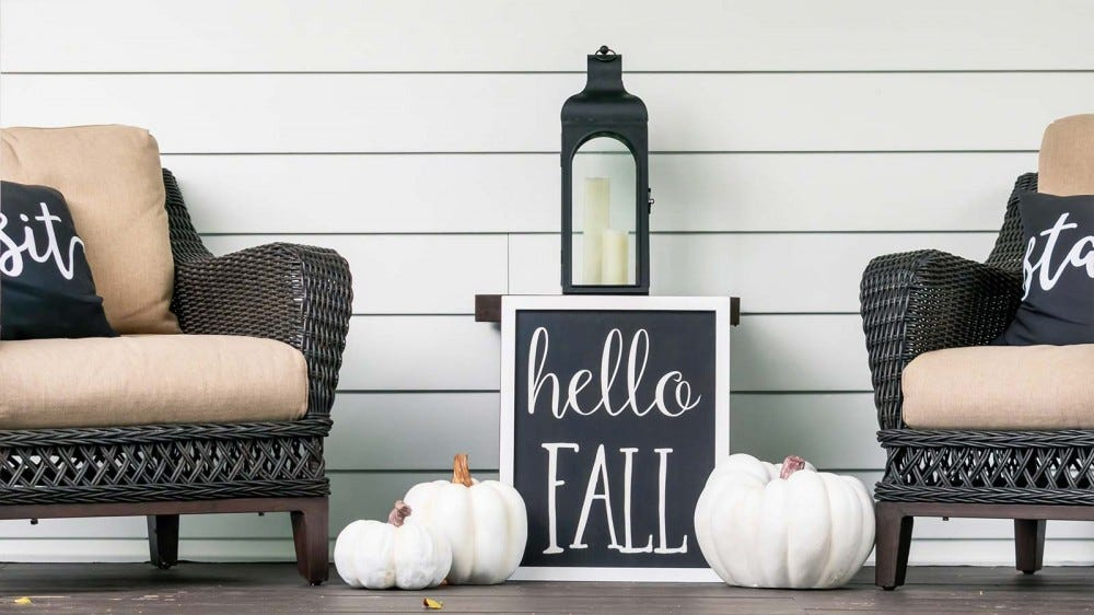 Monochromatic fall decorations on a porch.