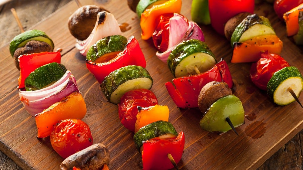 Kabobs on a cutting board, fresh off the grill.