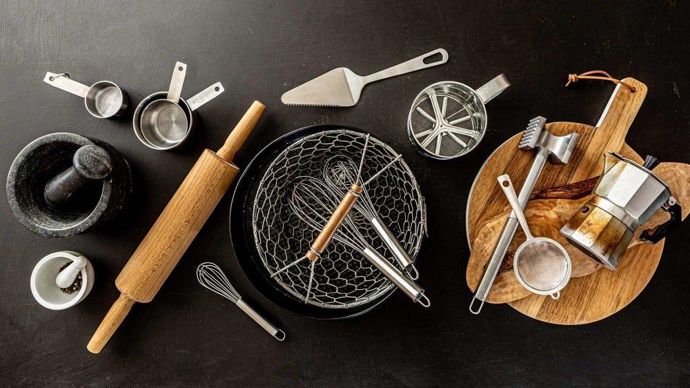 An assortment of kitchen gadgets on a black counter.