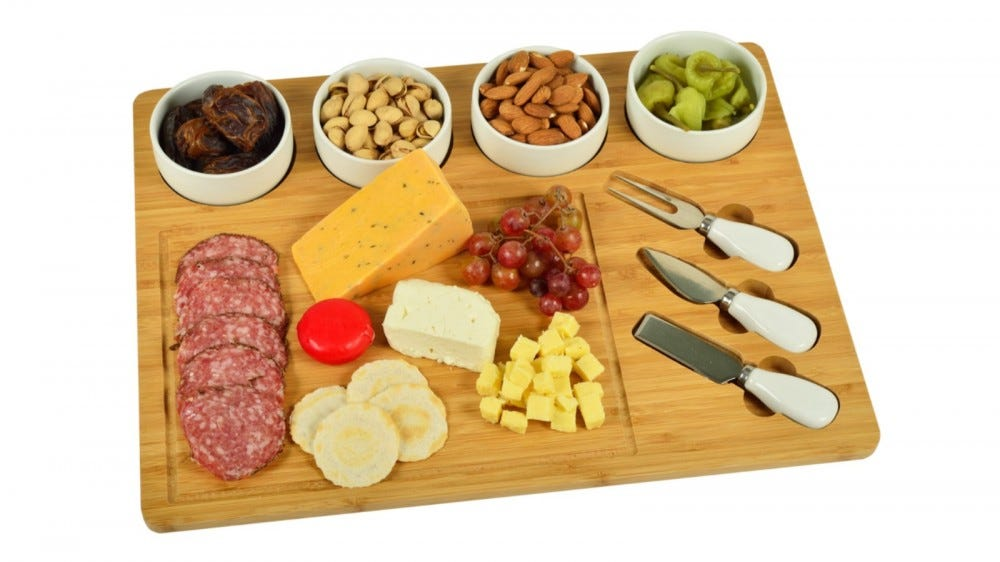 The Picnic At Ascot Four-Bowl Entertaining Set with meats, cheeses, and assorted nuts.