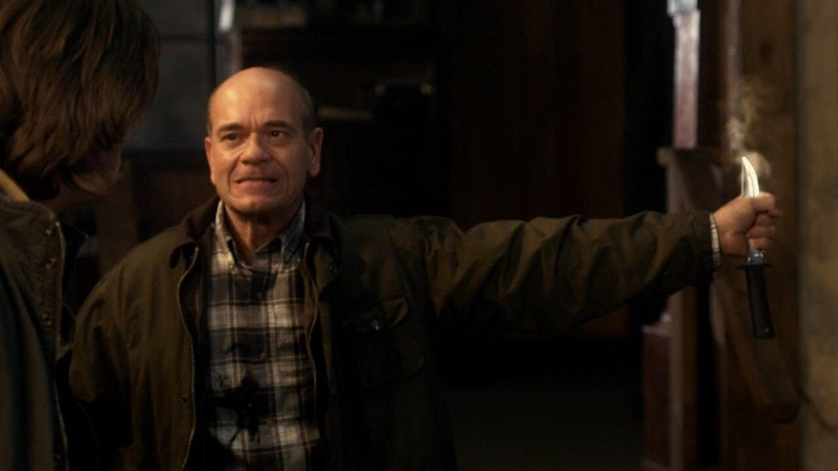 "Robert Picardo holding a knife as Wayne Whittaker on ""Supernatural."""