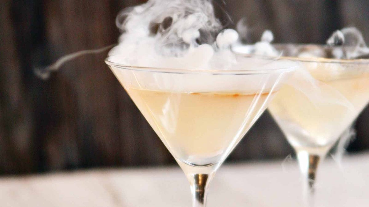 Two La Llorona Epicurious Cocktails with dry ice fog rolling out of them.