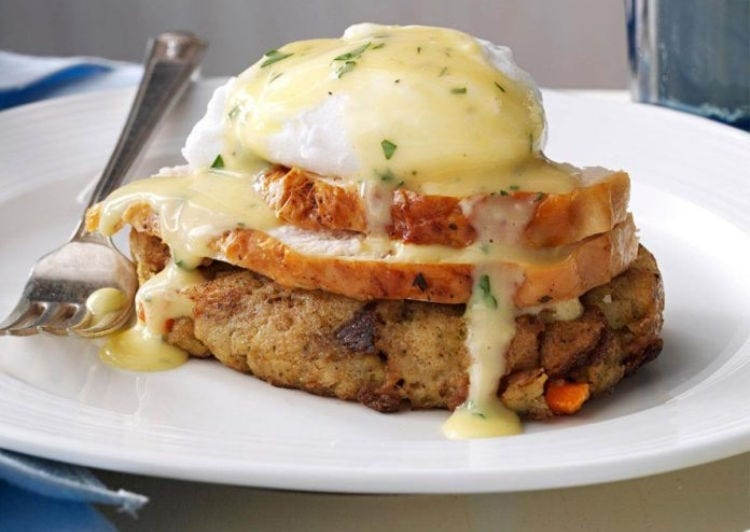 A handmade stuffing patty topped with sliced turkey, a poached egg and fresh hollandaise sauce.