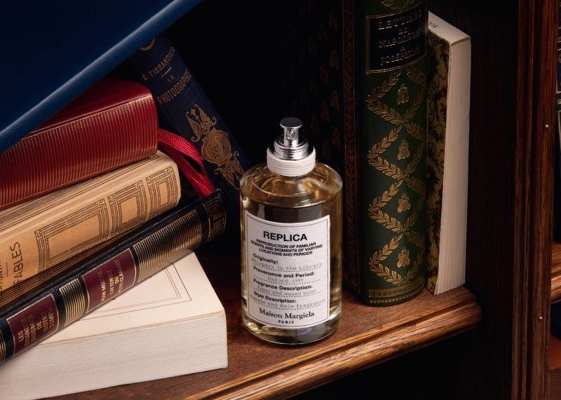 A bottle of replica Maison Margiela sitting on a bookshelf.