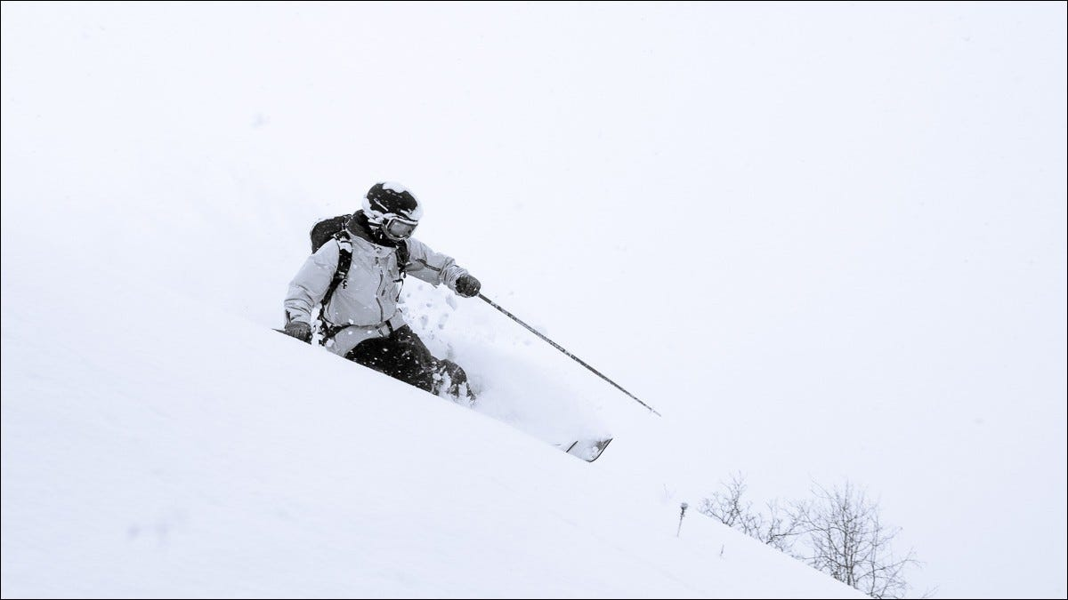 skier banking on snowy slope