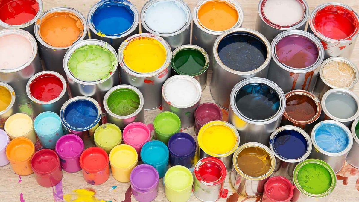 many colorful cans of paint, open to display the paint inside
