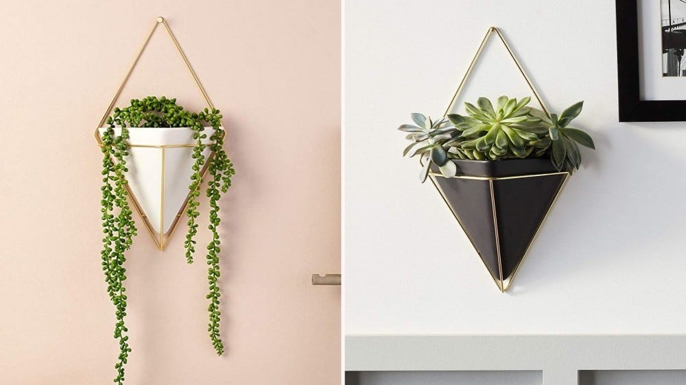 White and black triangular hanging planters.