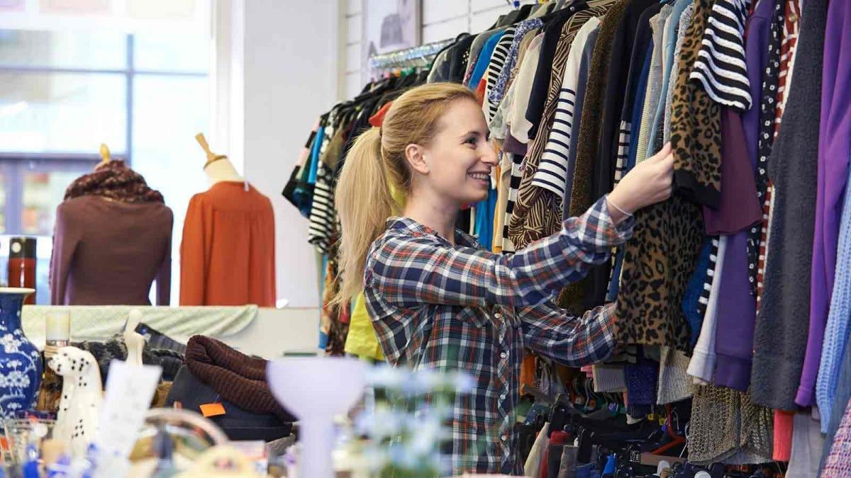 Woman shopping for clothing in a thrift store
