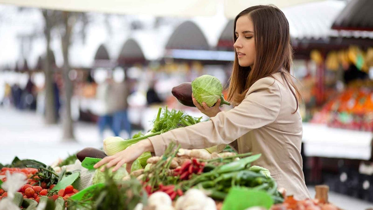woman shopping at a farmers market