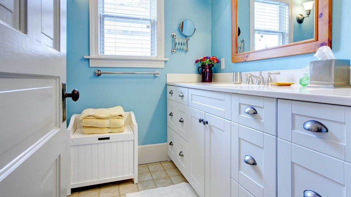 a sparkling clean bathroom with plenty of storage space under the sink