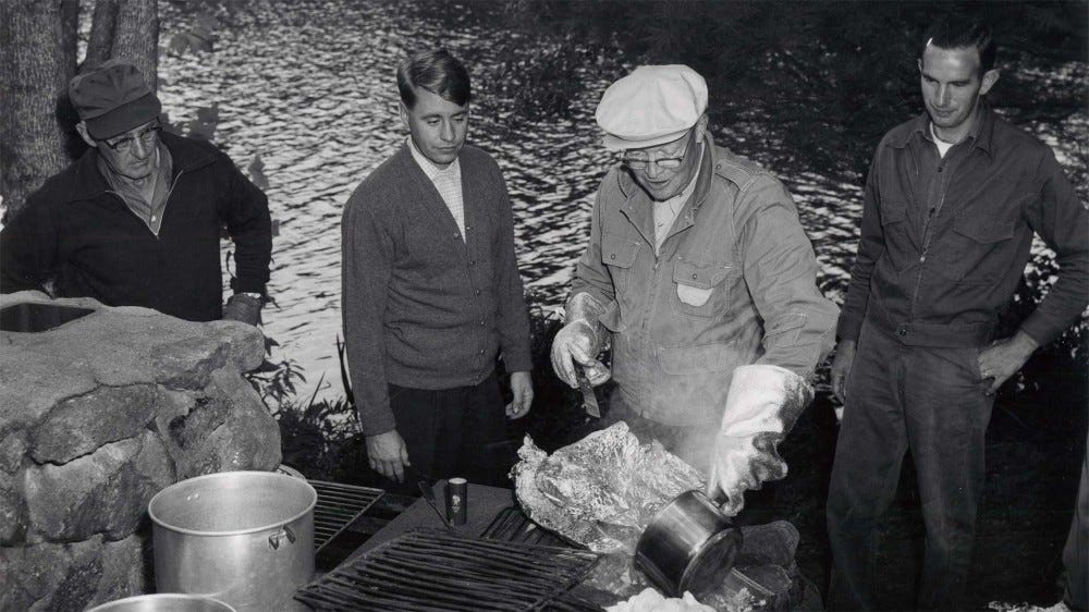 President Eisenhower cooking at a camp site.