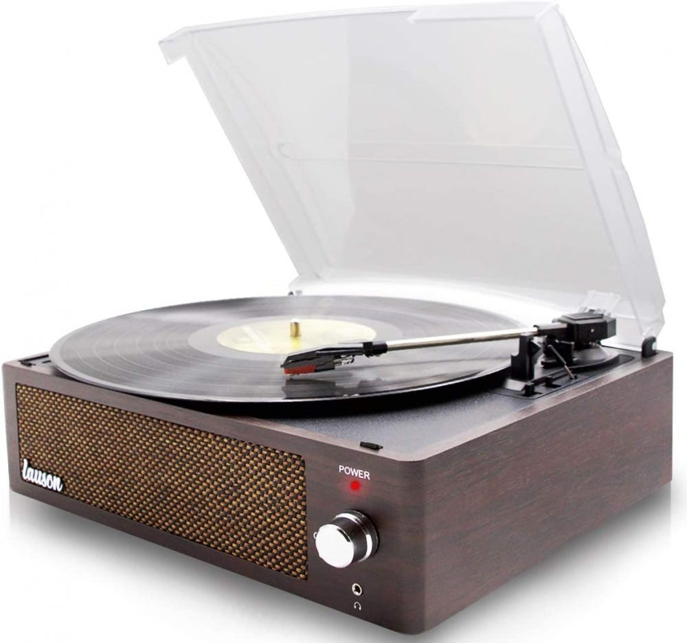 Wood-based record player, open with a clear lid