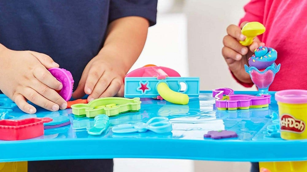 A Play-Doh activity table that helps keep the mess of creative play contained.