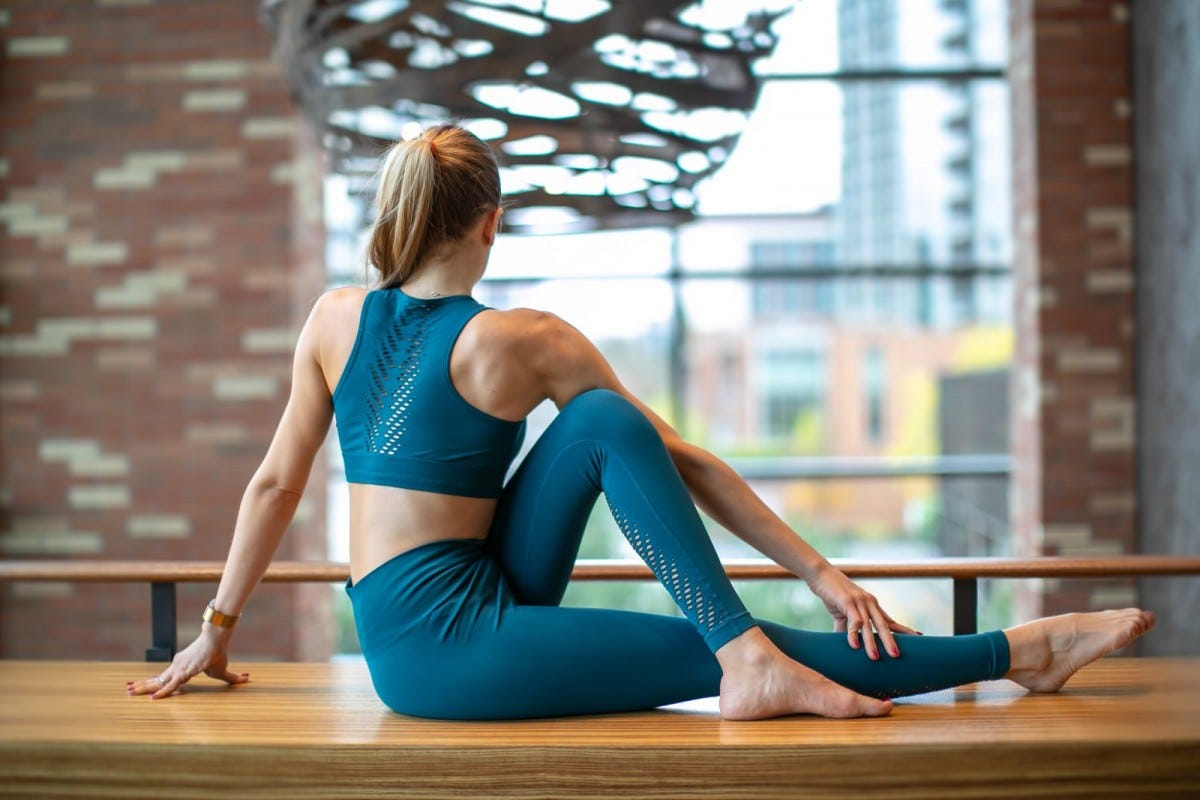 A woman in the Seated Twist Yoga pose.