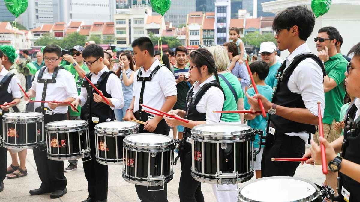 Singaporean students performing a St. Patrick's Day parade