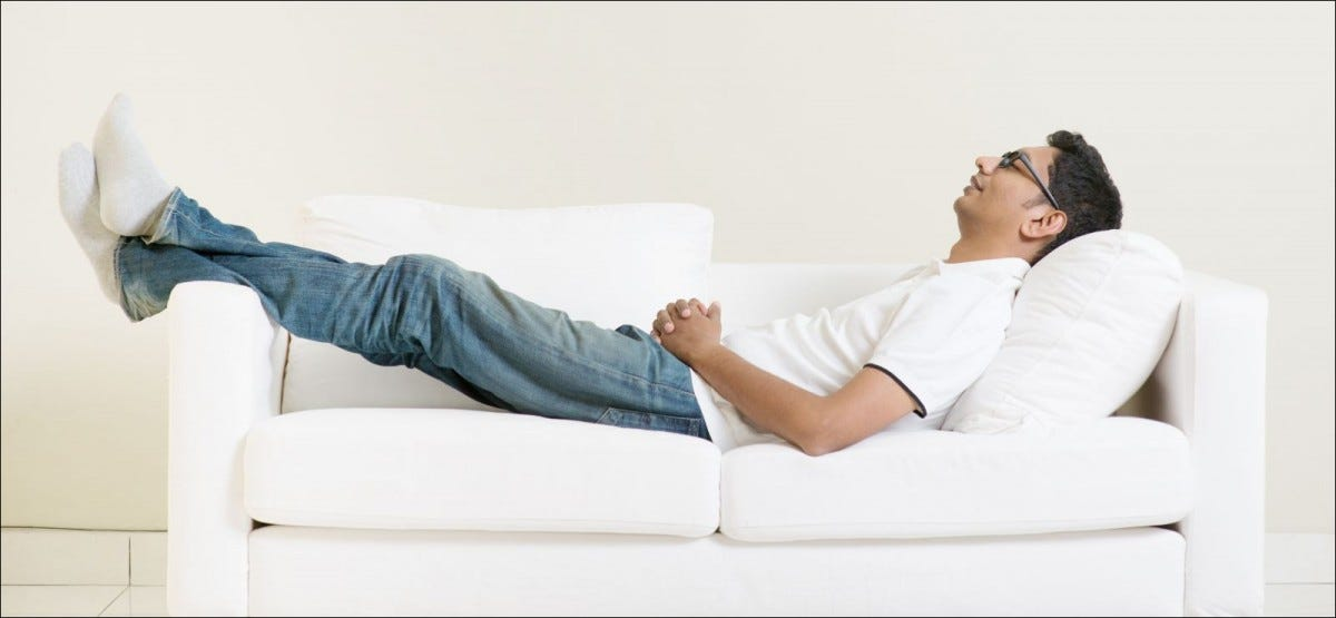 man resting on sofa