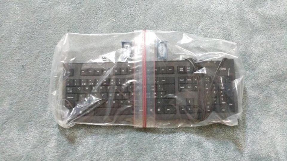 A keyboard sealed in two Ziplock bags.
