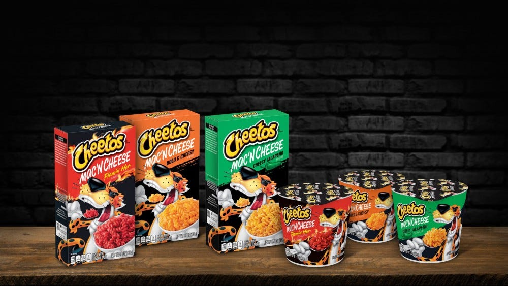 The different versions of cheetos mac and cheese are arranged on a table.