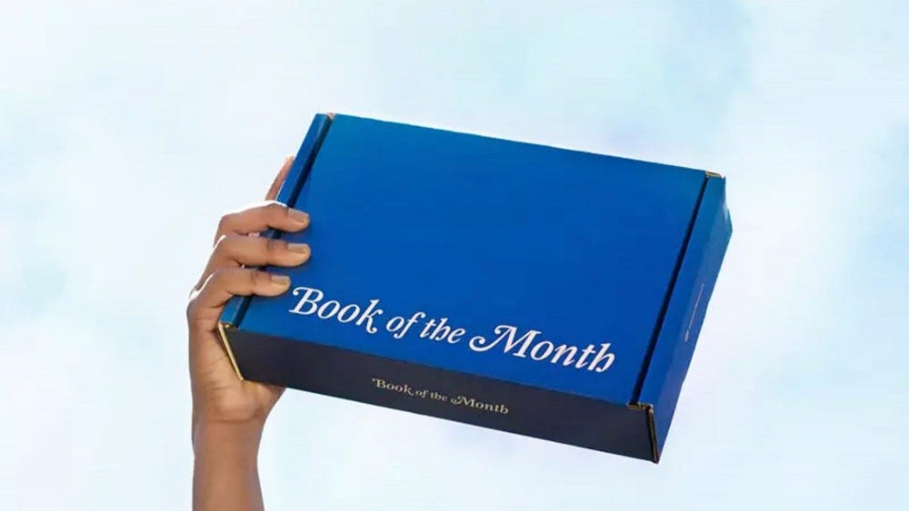 Someone holding an unopened Book of the Month box.