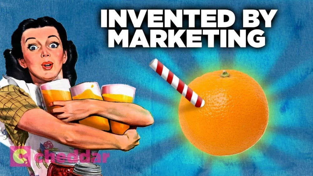 A vintage orange juice ad showing a woman holding giant glasses of orange juice.