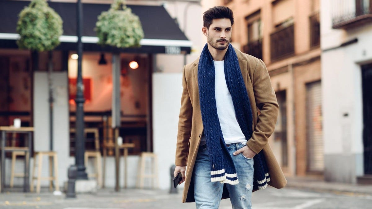Man wearing a stylish winter coat and scarf