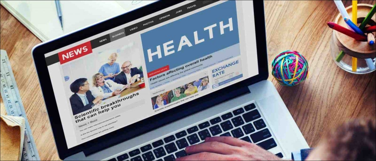 laptop showing news coverage on health