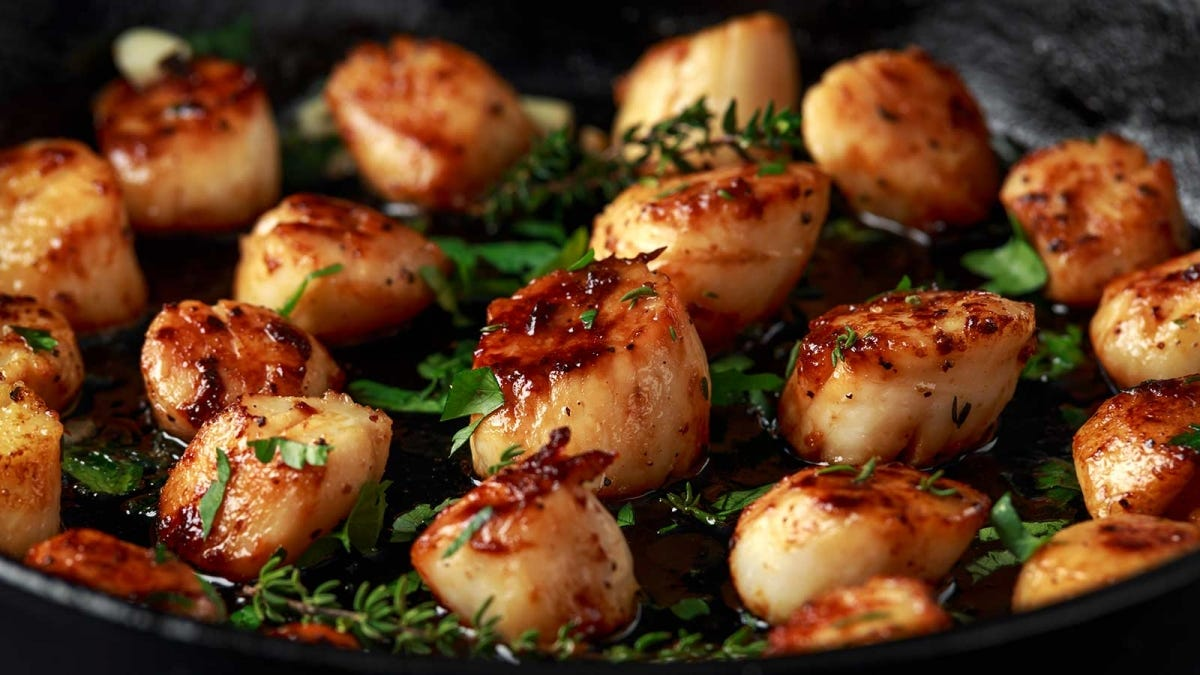 Scallops seared in garlic and butter.