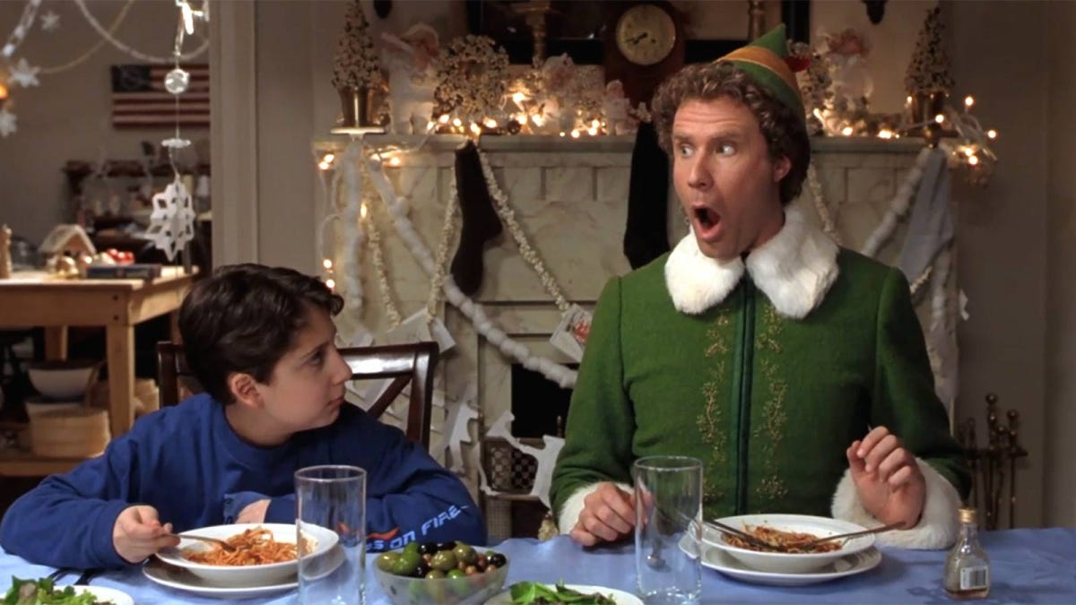 Buddy the Elf enjoying a delicious plate of spaghetti and sugar.