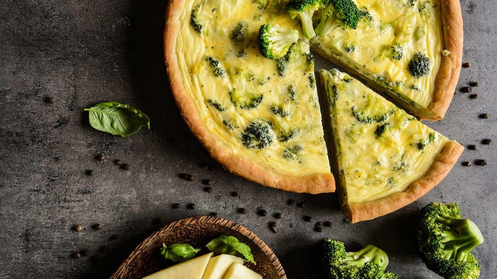 Traditional vegetable quiche with broccoli and cheese.
