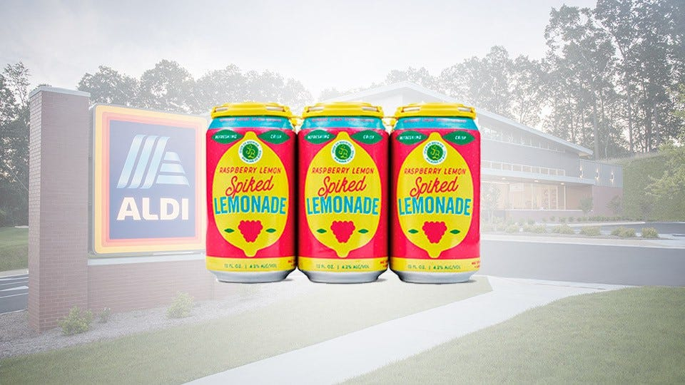 Three cans of Raspberry Lemon Spiked Lemonade super-imposed over an ALDI store.