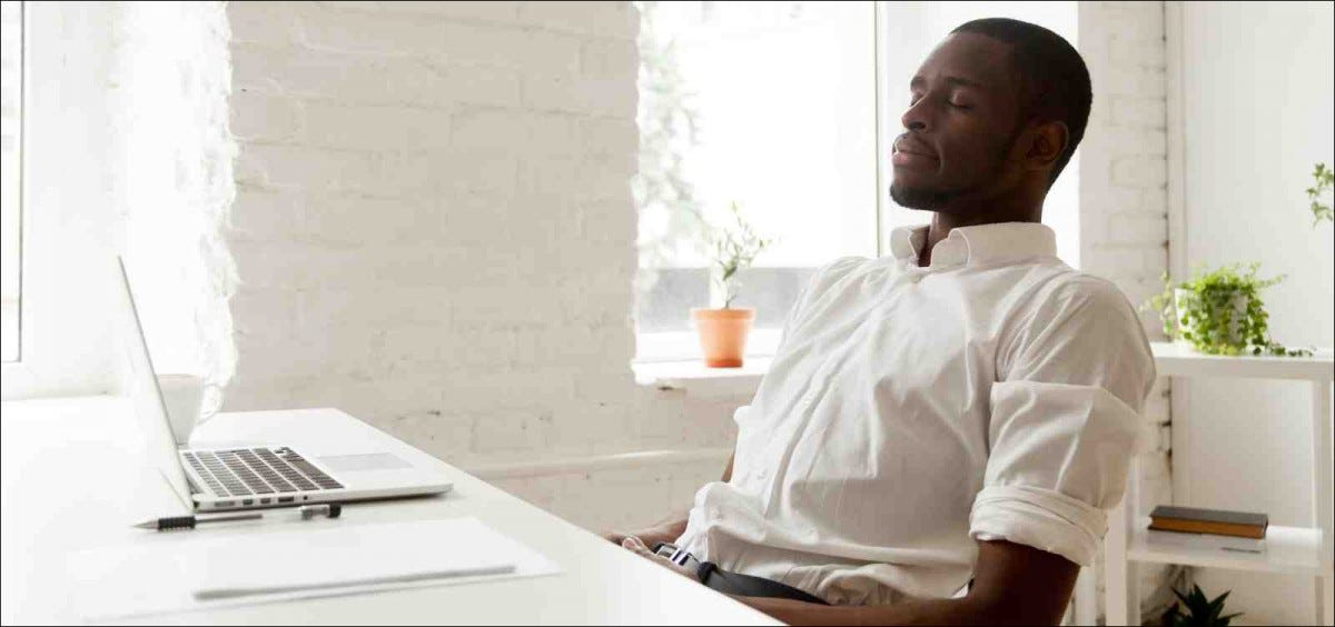 man meditating at desk
