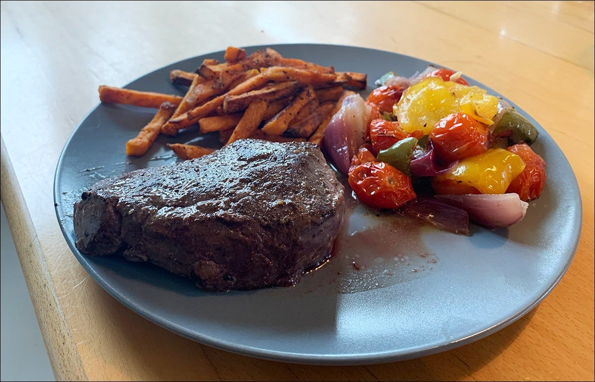 A seared steak, plated with vegetables