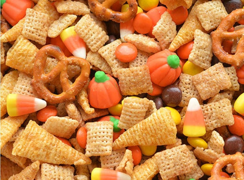 Halloween Harvest Chex Mix, made with pretzels, chex, candy corn and Reese's.