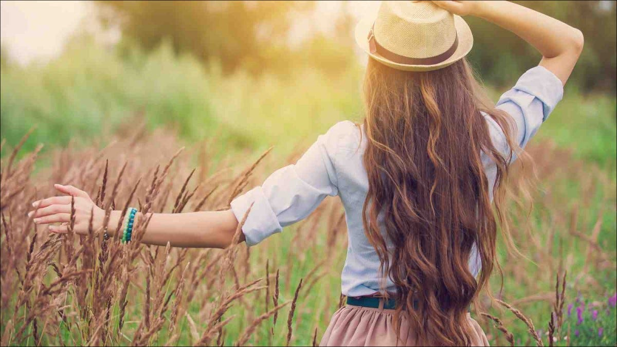 rear view of young girl with long hair outdoors