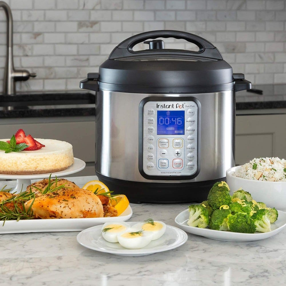 An Instant Pot sits on a countertop surrounded by food.